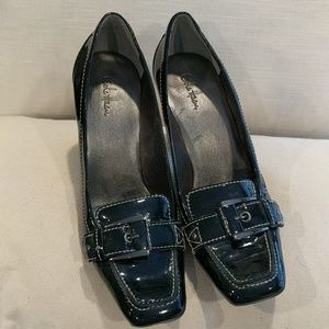 Black patent leather heeled loafers